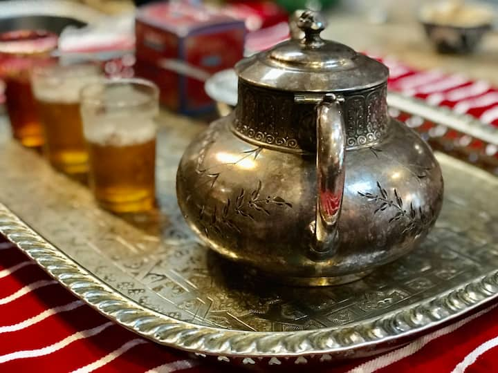 Moroccan teapots are engraved metal.