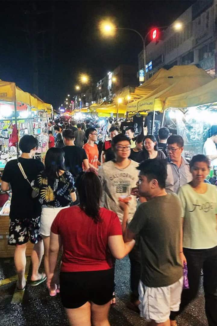 Crowded people at night market.