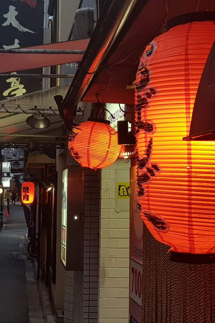 Red lanterns (chochin) show food types.