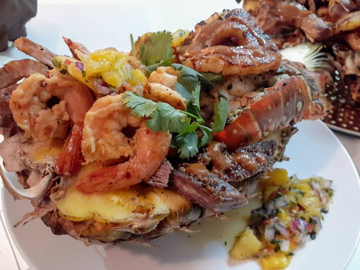 Bahamian Meal served in a pineapple bowl