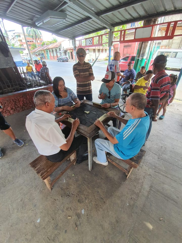 Locals playing domino at the park.