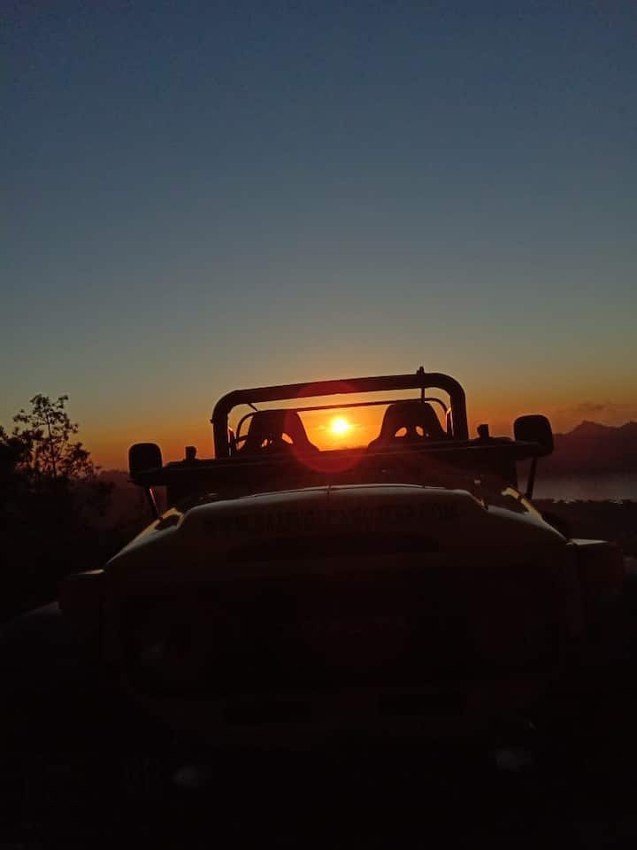 Sunrise with classic jeep
