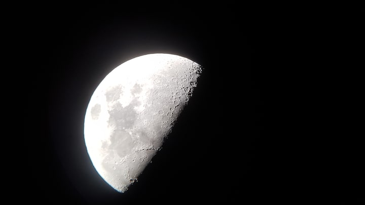 moon through the telecope with mobile