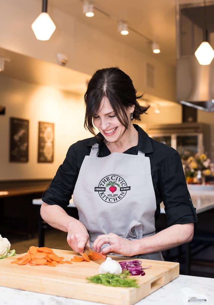 Chef Jen demonstrating knife skills.