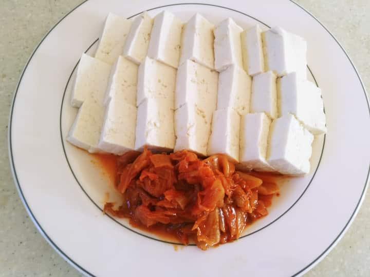 warm tofu with stir fried gimchi