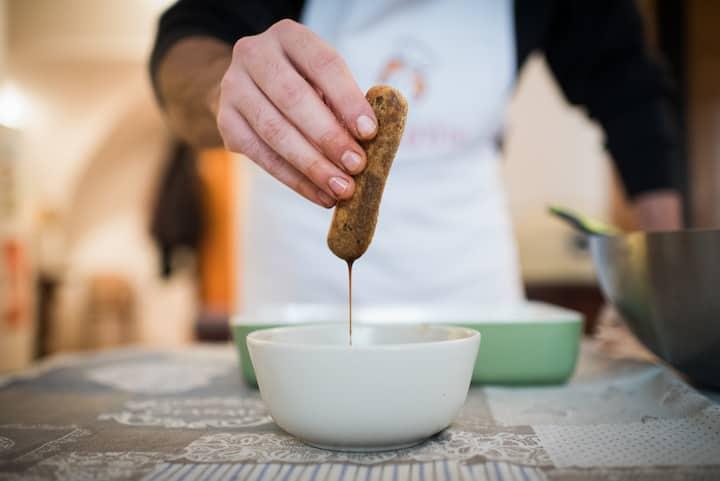 Tiramisu: dipping Savoiardi in coffee
