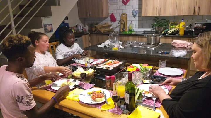 Family and friends having Raclette