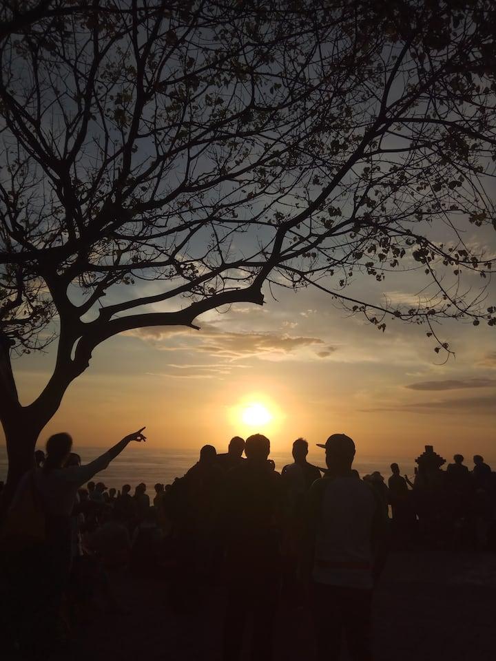 Sunset at 1000 years old Uluwatu Temple