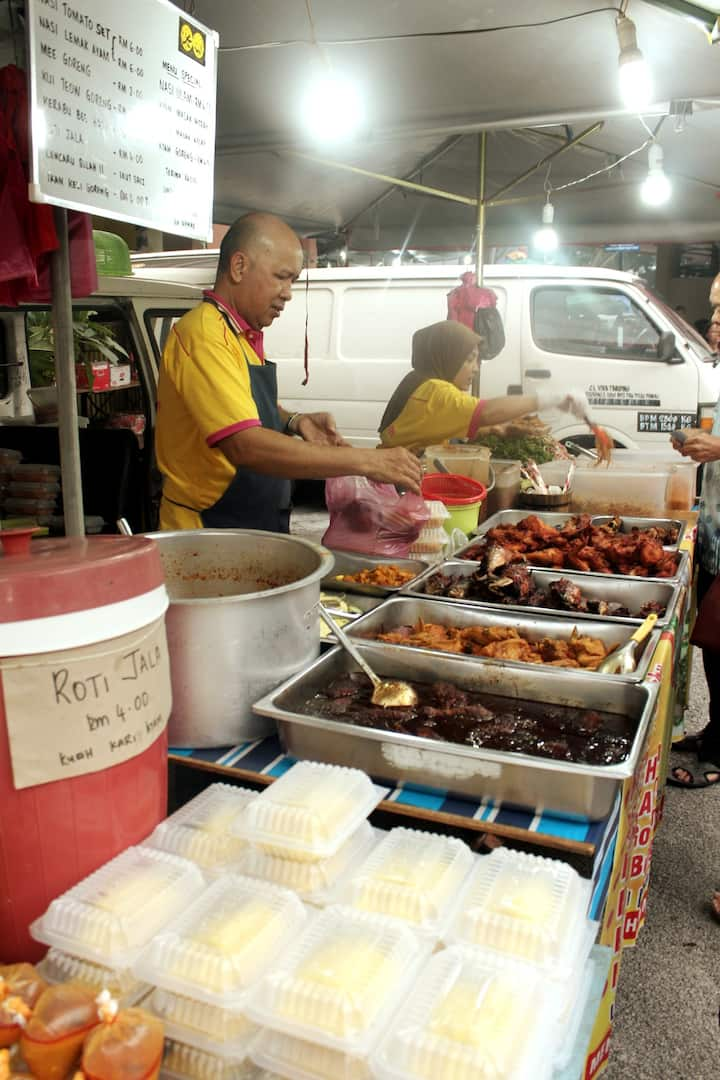 Nasi Lemak stall with plentiful dishes