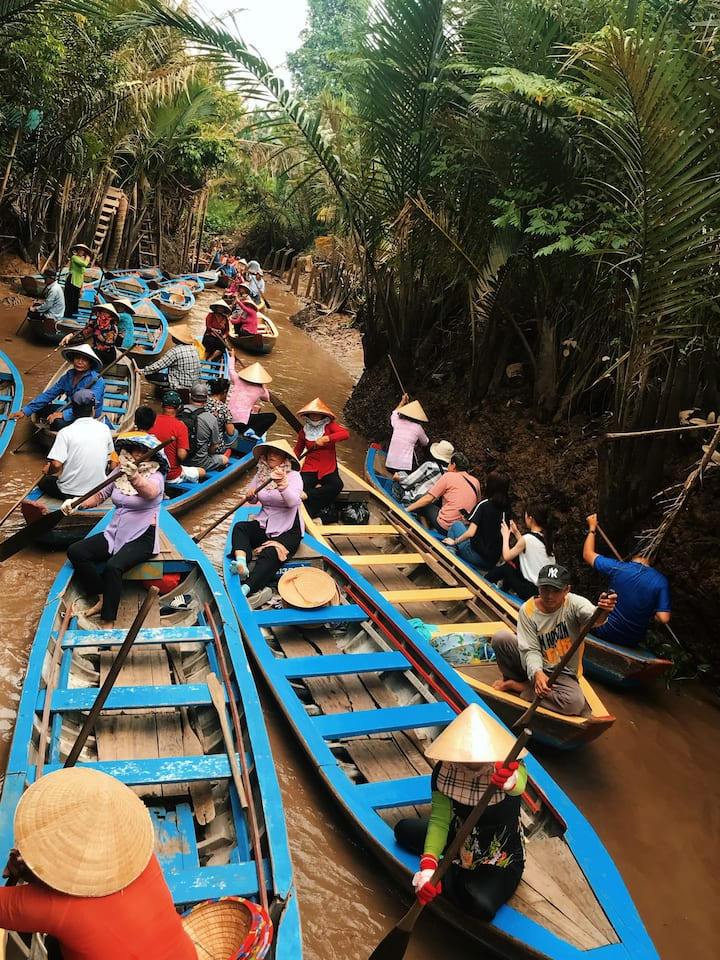 Rowing boat in the coconut canal