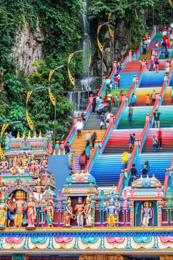 Colorful Batu Cave temple stairs.