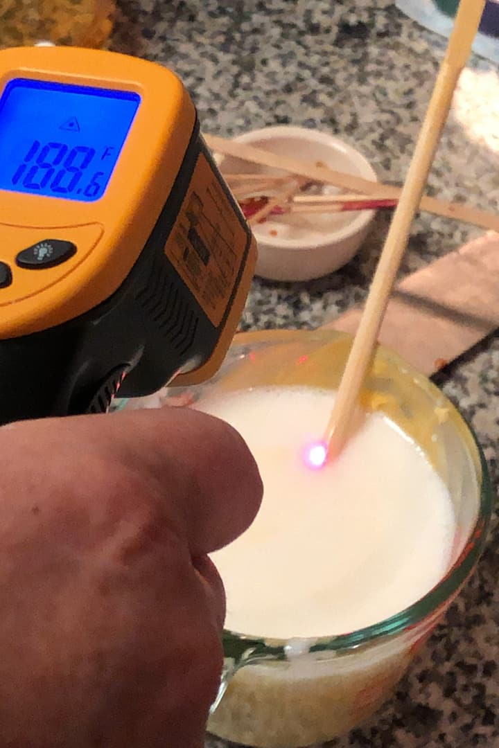 Testing the temperature of the soap