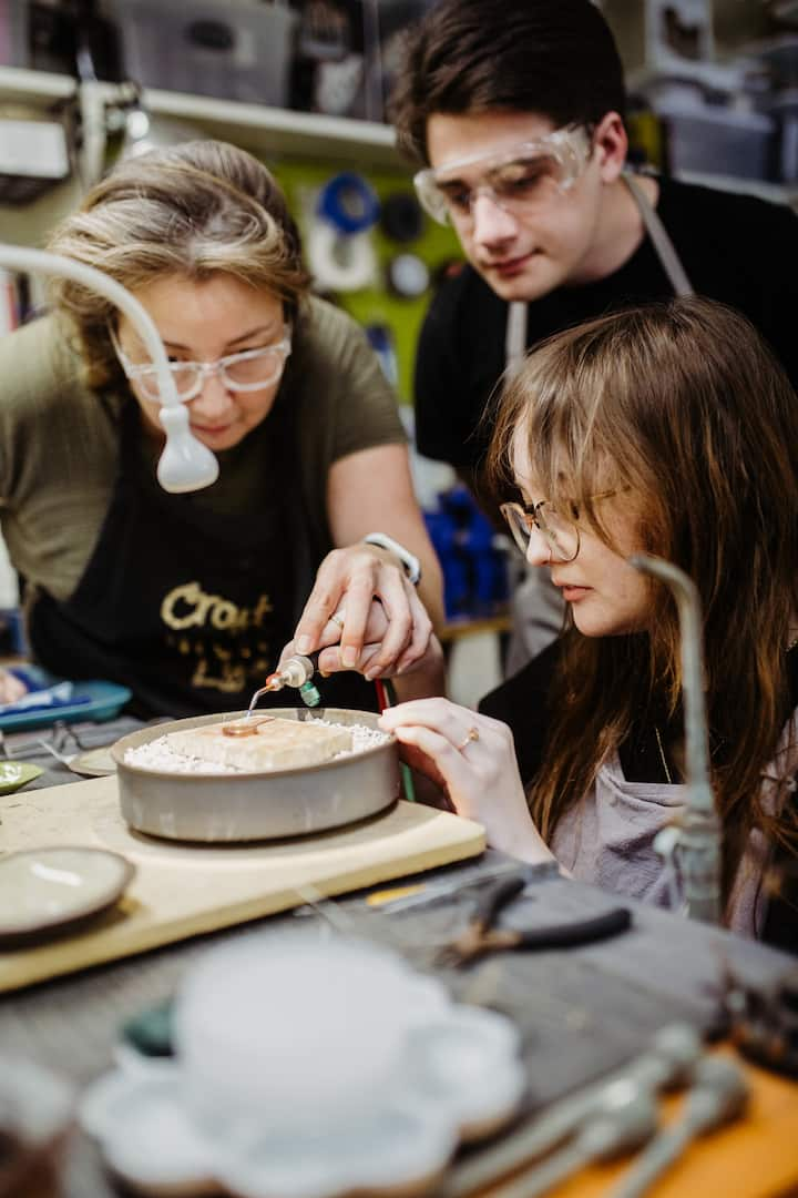 Couples use torches to solder each ring