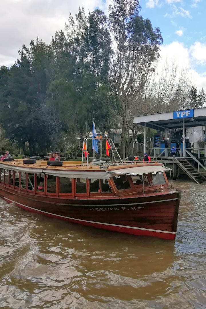 Traditional wooden boat and gas station