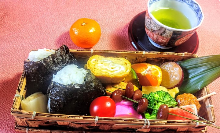 Bento,  including  rice balls, omelets