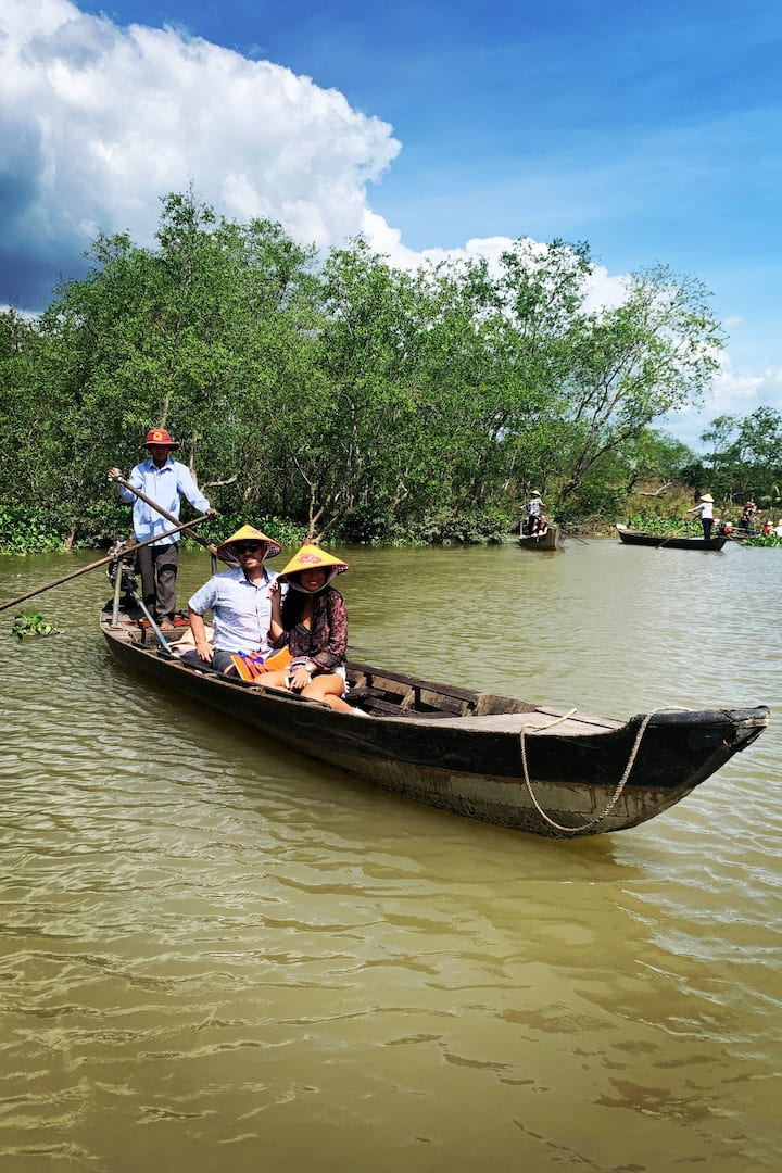 Rowing boat through the mangrove canal