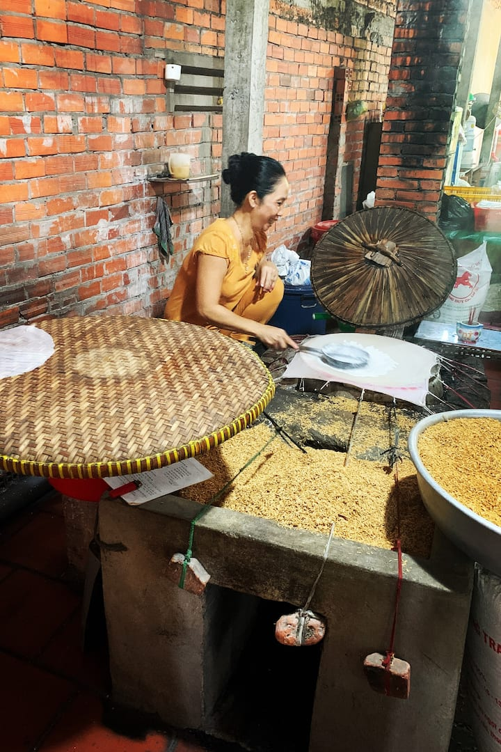 Rice paper making lady at the village