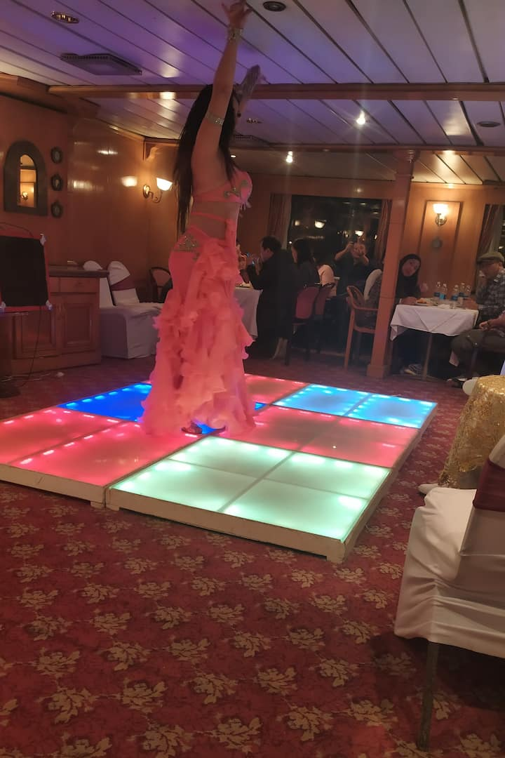 The ORIENTAL DANCE IN THE NILE DINNER CRUISE IT'S INCLUDING THE TRANSPORTATION FROM YOUR HOTEL TO COMEBACK TO YOUR HOME THEMAGIC TOUR