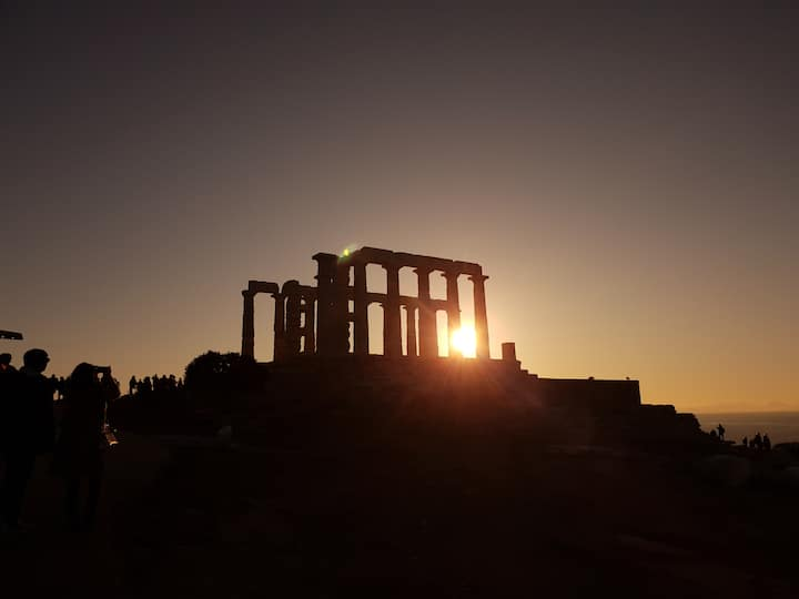 Sun setting behind Temple of Poseidon