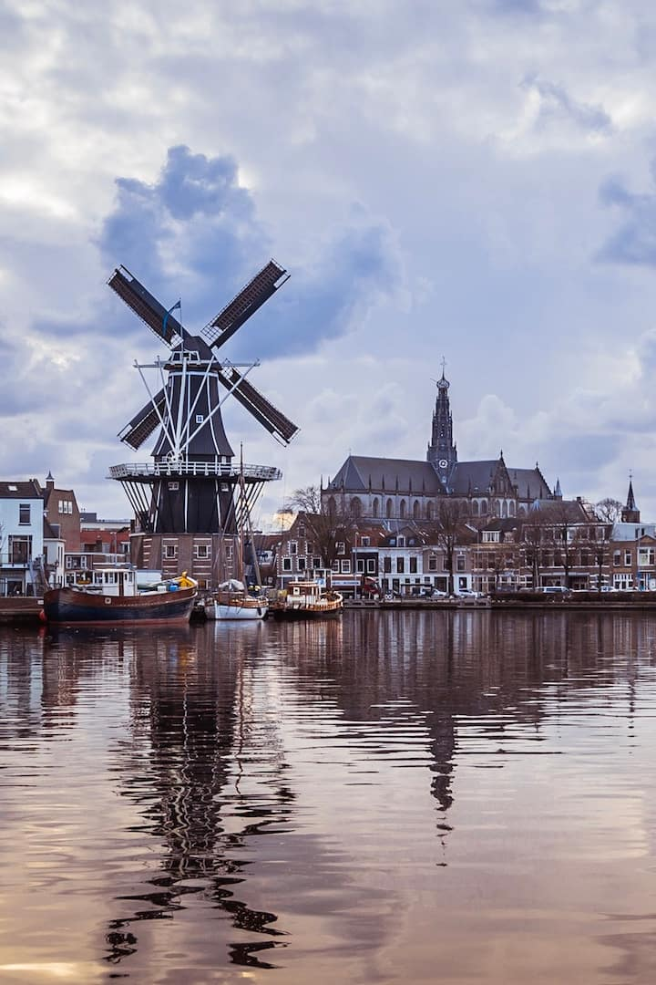 Picturesque canal Spaarne with windmill
