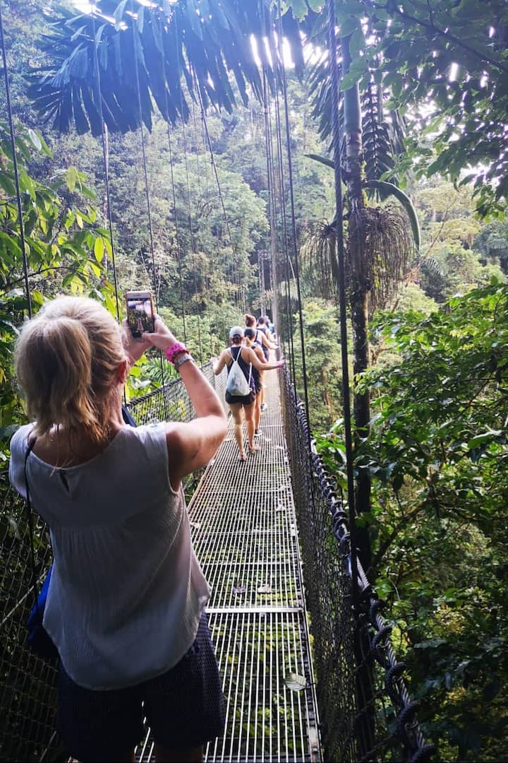 Tourists crossing the first hang bridge