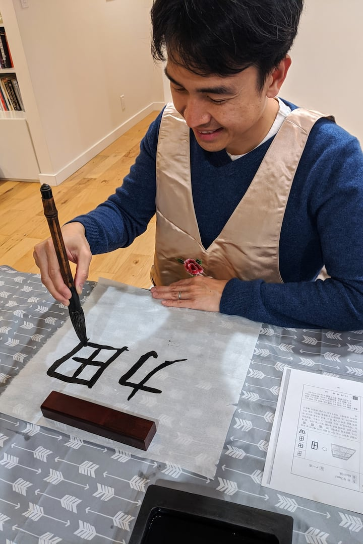 Guest having fun with calligraphy