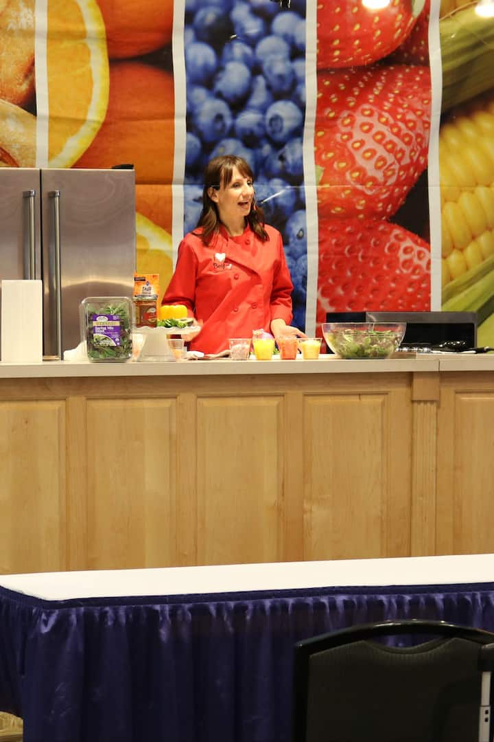 Leading a cooking demo at a conference