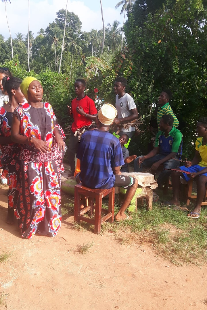 Local women singing and dancing