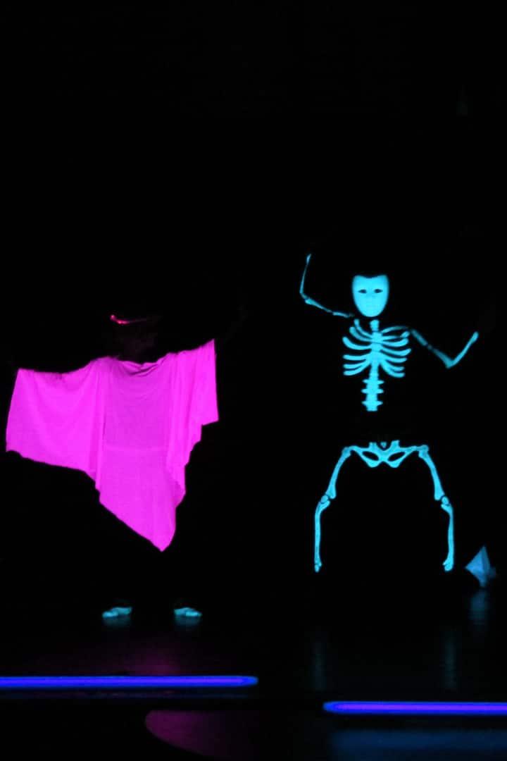 Black light theatre show action