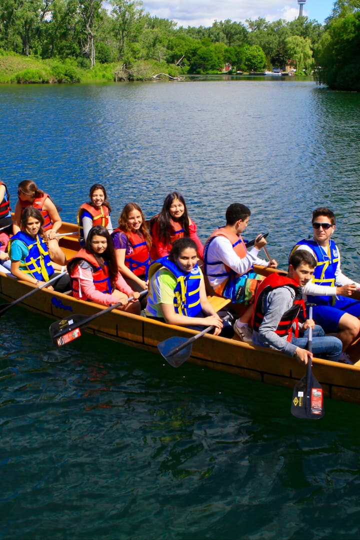 team building activity paddling canoe