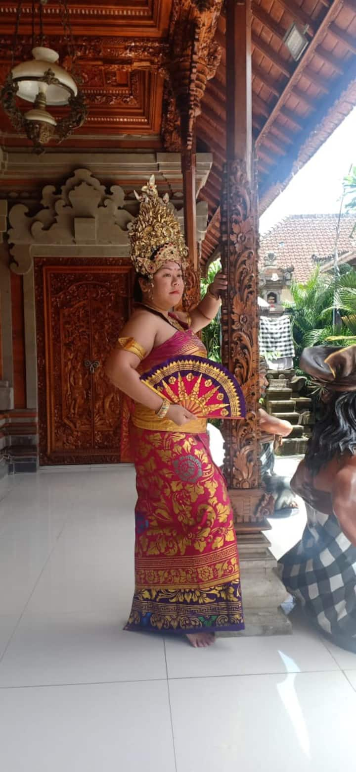 Posed like a Balinese princess