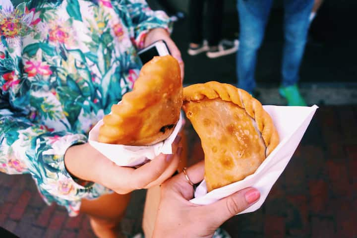 Cheers with beef empanadas
