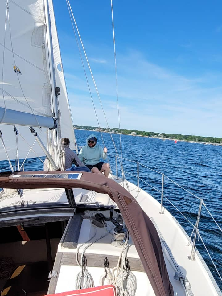 Father and son enjoying a sail at the