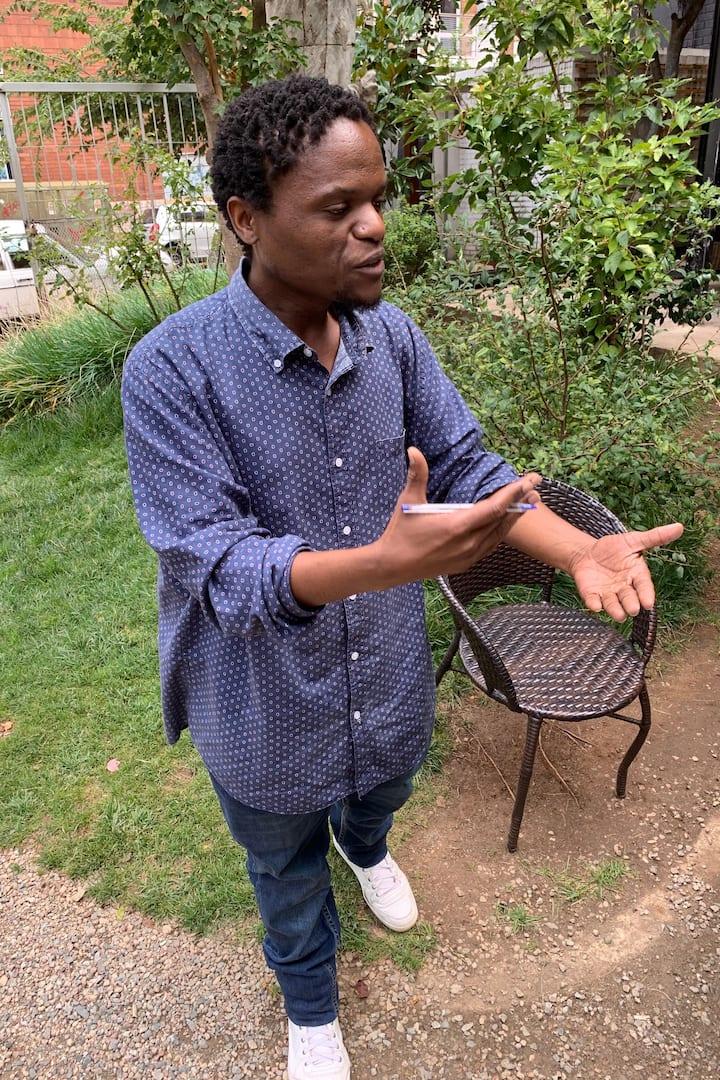 Thabiso teaching in the garden