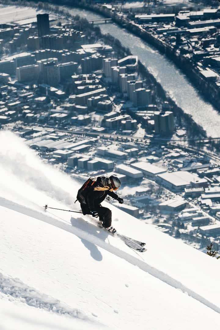 Ski above the city.