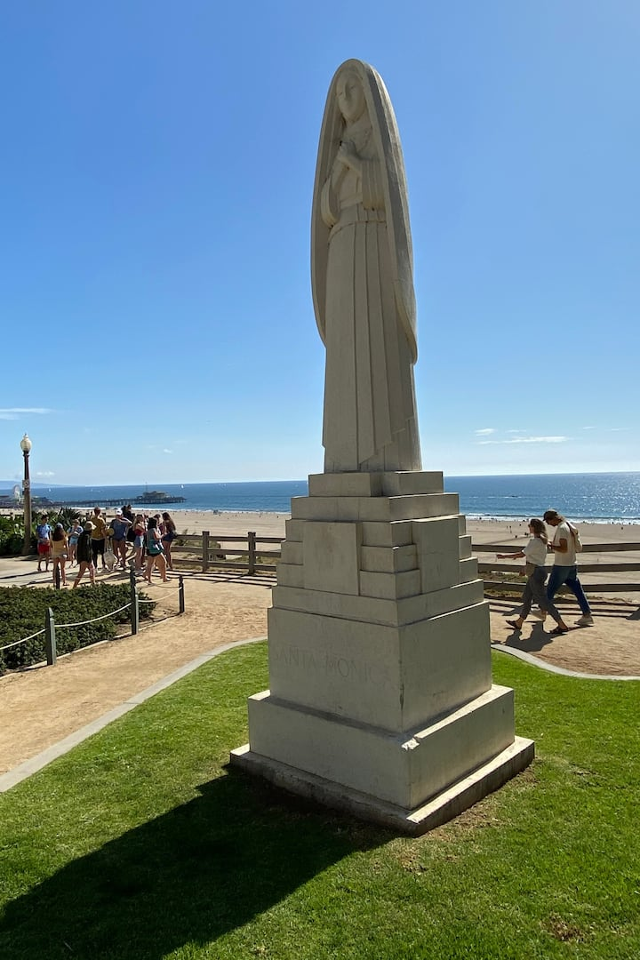 Stroll by the statue of Santa Monica