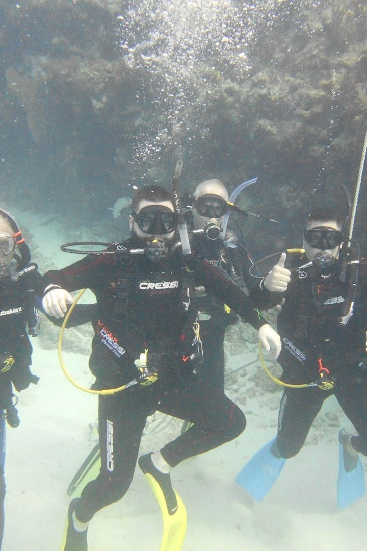 Fathers and sons on first ocean dives