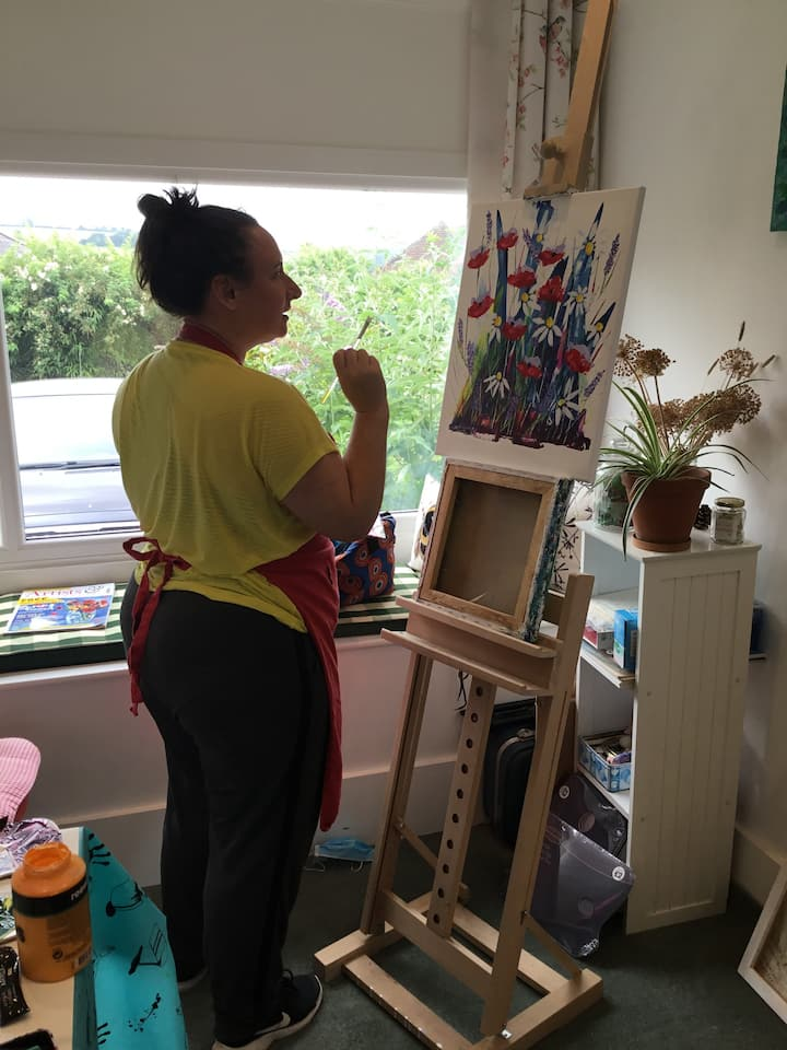Marie completing her first painting