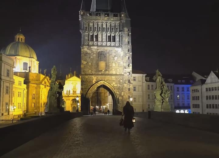 Walking over the famous Charles Bridge