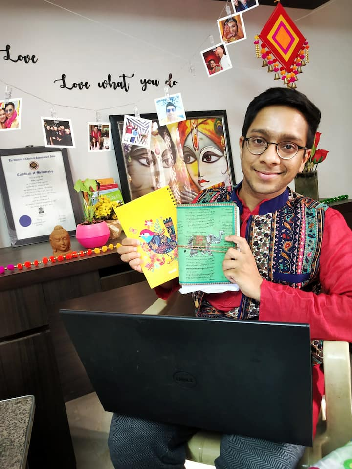 Picture of me showing my art diaries