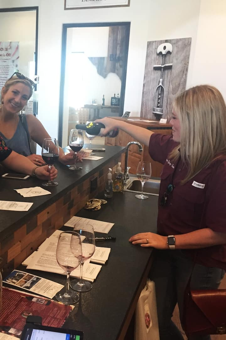 Owner, Courtney, pouring wine