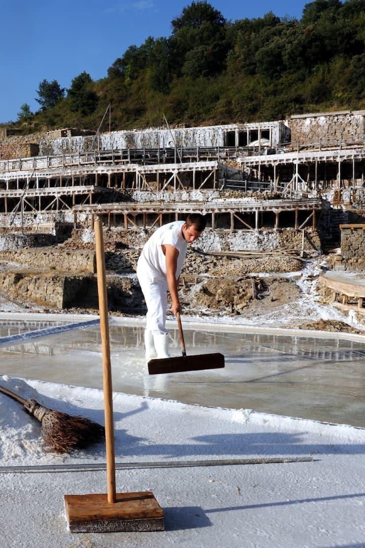 Picking up salt at Añana Valley