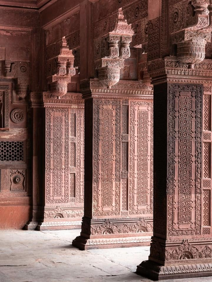 Carved red sandstone pillars