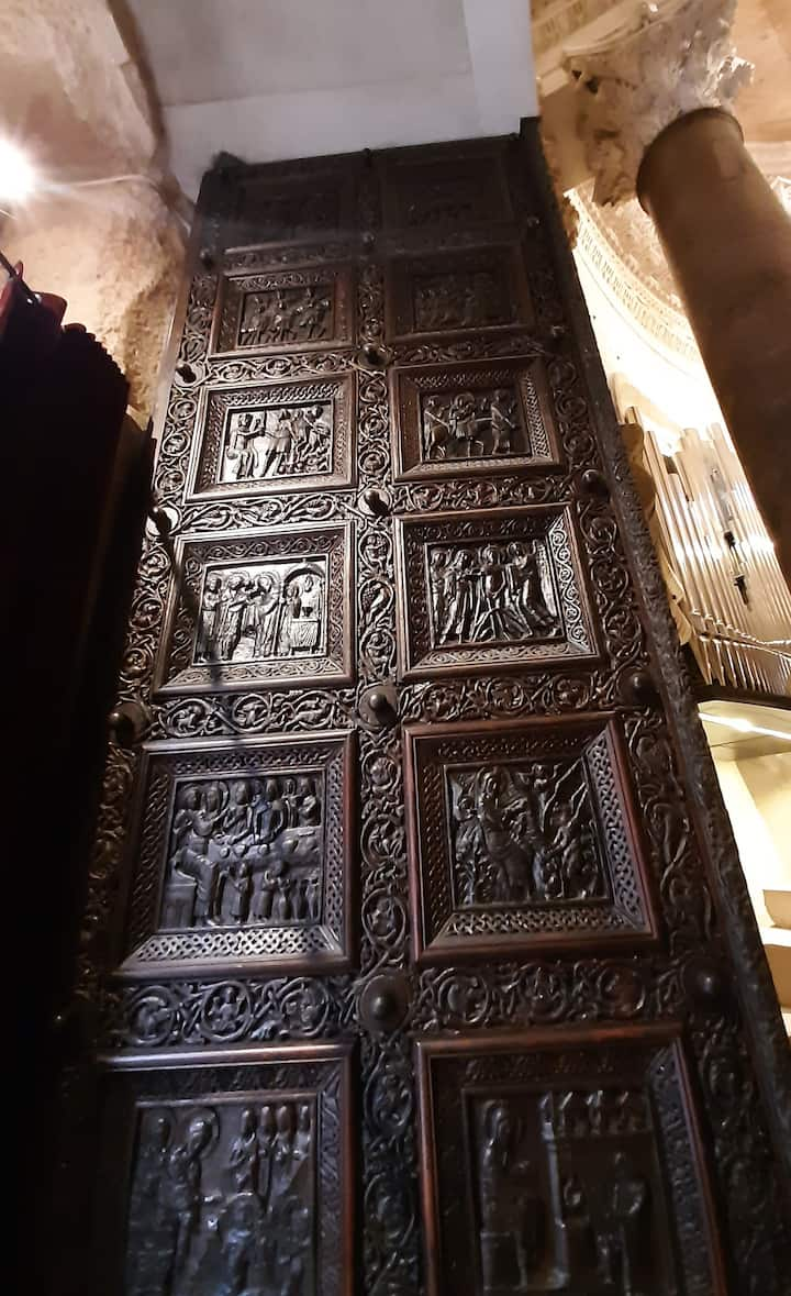Carved in 1214, massive double doors