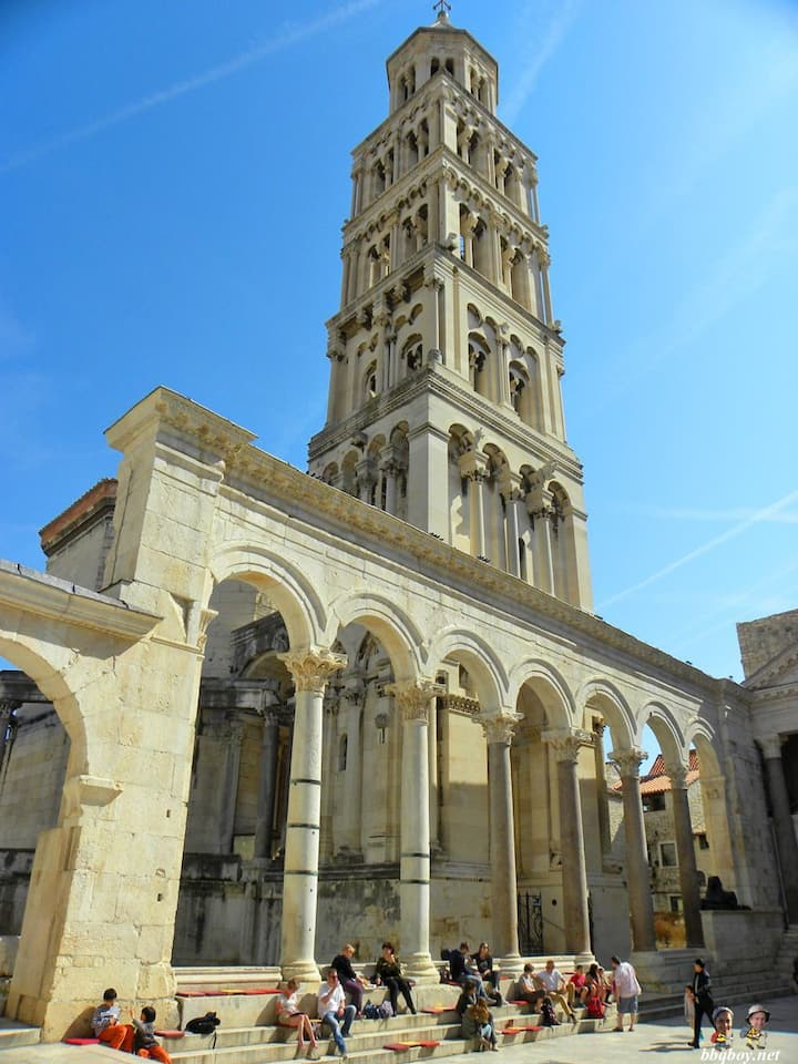 The restored facade and 13thC belltower