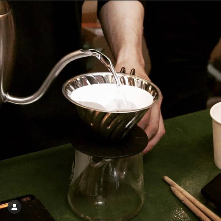 Pouring the hot water to cook the coffeepowder