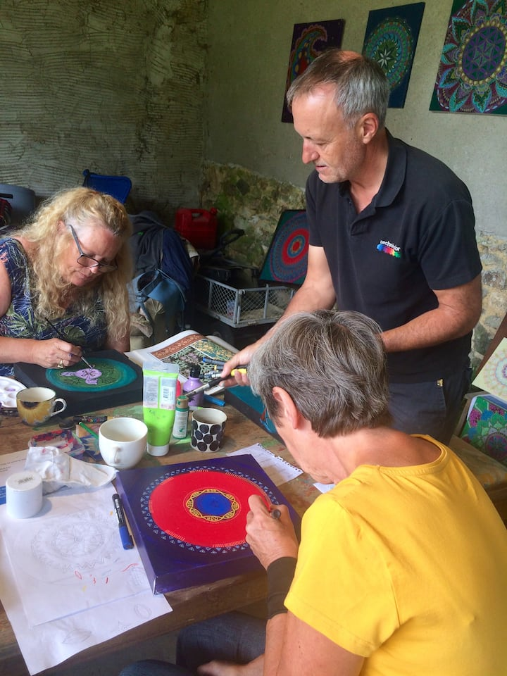 Artists enjoying the mandala workshop