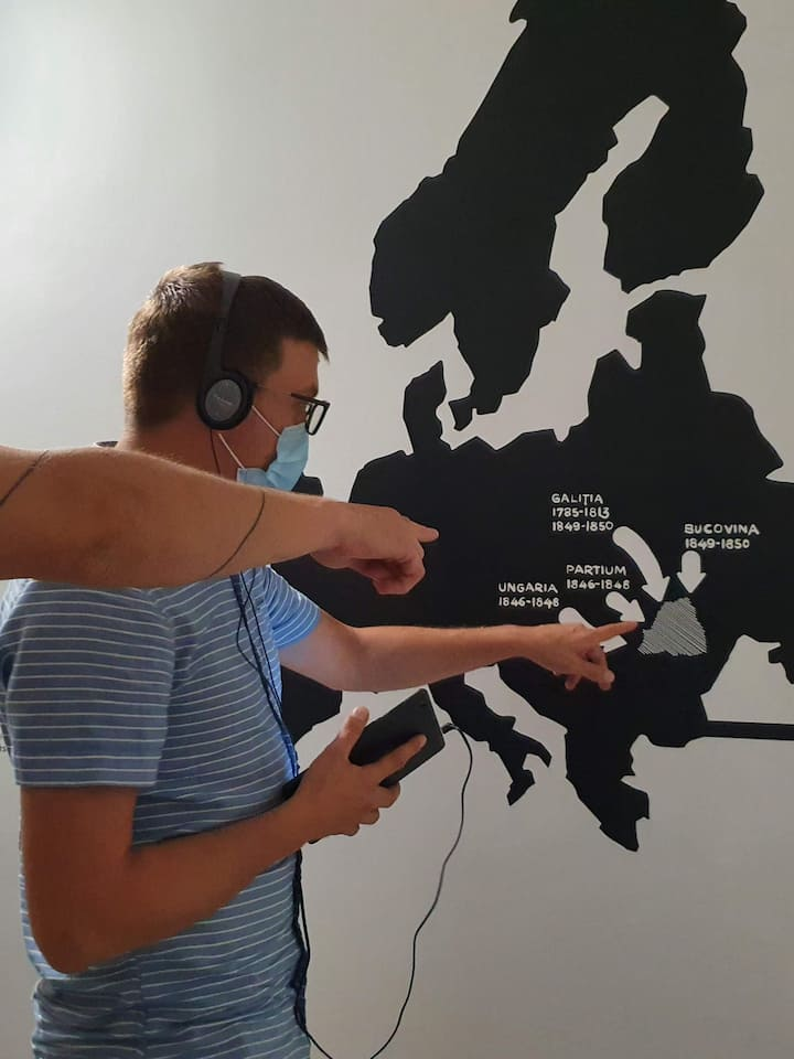 Visitors pointing at a map.