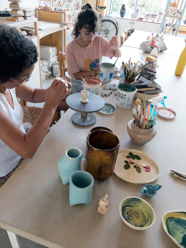 Painting with clay slips.