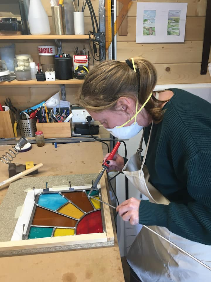 Student soldering her first lead panel